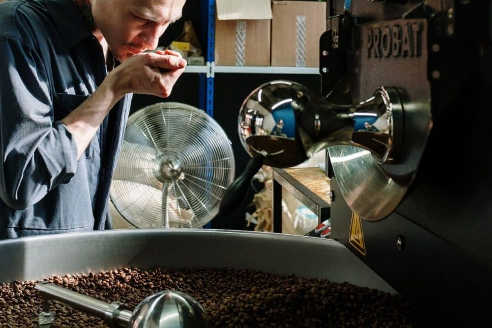 Coffee Roasters Smelling Beans Image