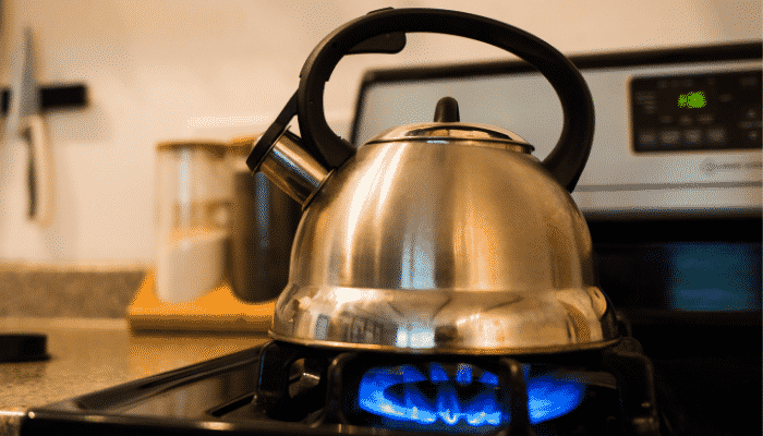 Boiling water on stove Image